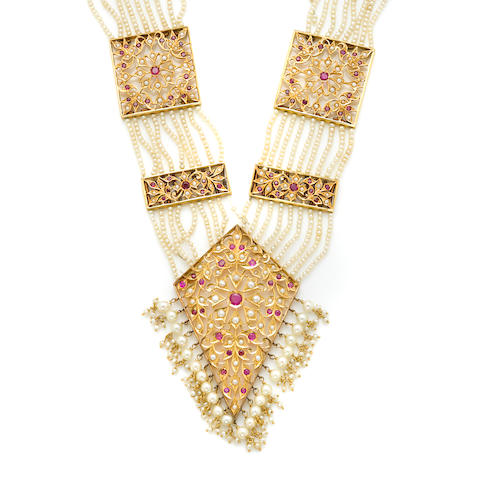 A ruby, seed pearl and gold plaque necklace