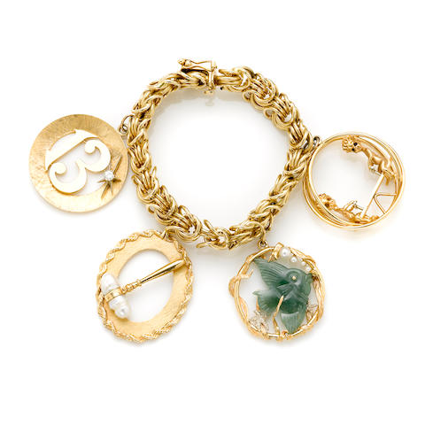 A gem-set and gold charm bracelet with 4 charms