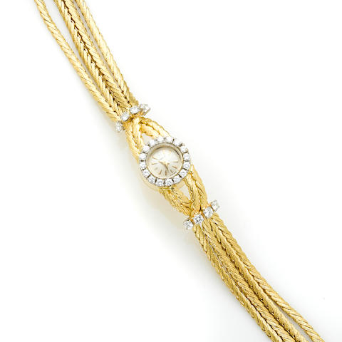 A diamond and 18k gold bracelet watch, Gubelin