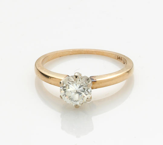 A diamond solitaire and 14k gold ring