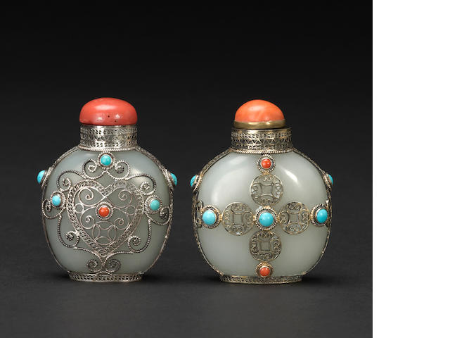 Two metal mounted jade snuff bottles