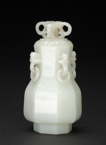 A white jade octagonal covered vase