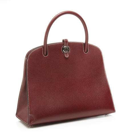 An Hermès burgundy leather Dalvy handbag