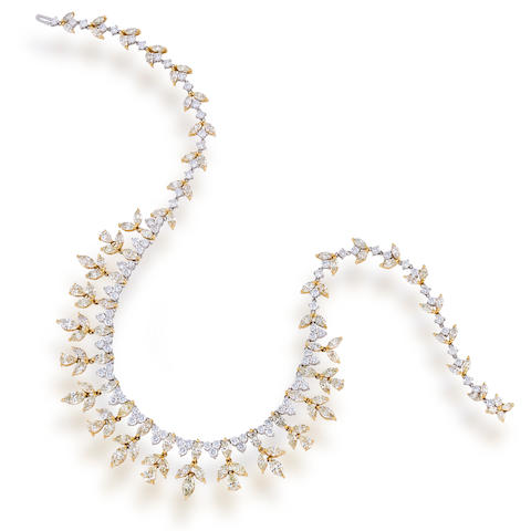A diamond and colored diamond fringe necklace