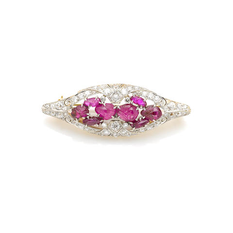 An art deco carved ruby and diamond brooch,