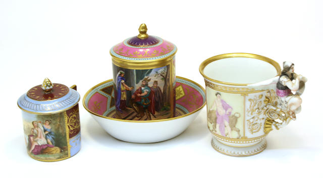 A Vienna style porcelain cabinet cup, cover and stand, Berlin porcelain figural cup and Vienna style covered can early 20th century