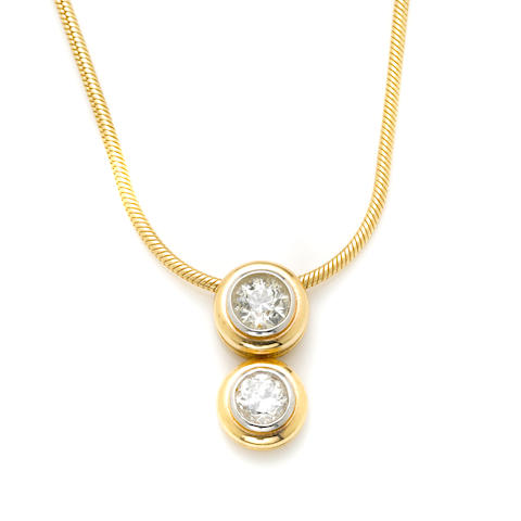 A two old European-cut diamond pendant with a gold chain necklace (diamonds weighing approx .60 and .90ct.)
