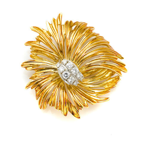 An 18k bicolor gold and diamond brooch,