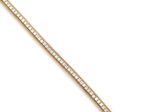 A diamond and 14k gold line bracelet
