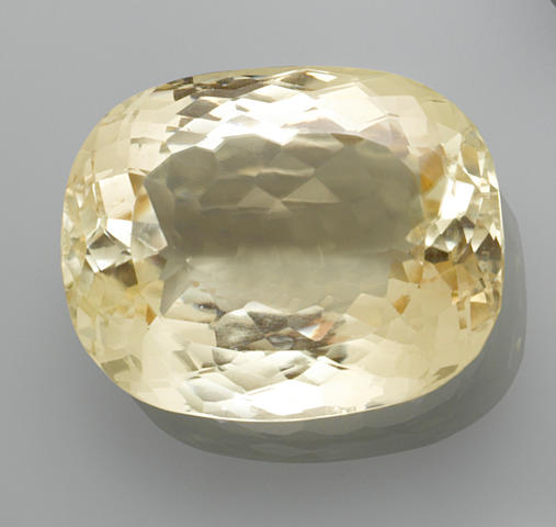 Very Large Yellow Spodumene—A  Member of the 100 Carats Club