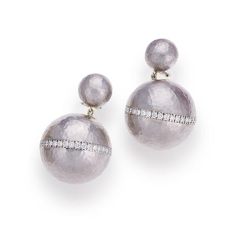 A pair of eighteen karat white gold and diamond pendant earrings, Paloma Picasso for Tiffany & Co.