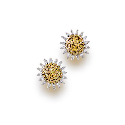 A pair of colored diamond and diamond earclips