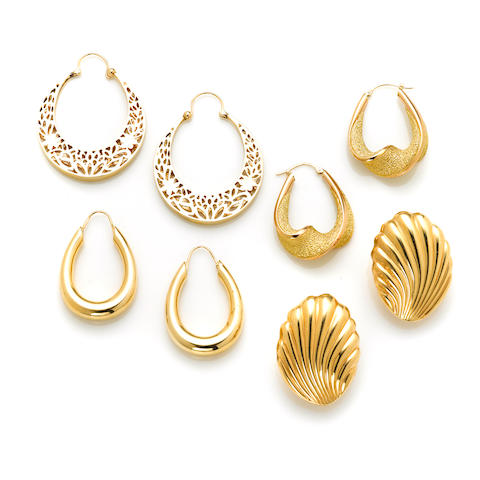 "A pair of pierced gold hoop earrings, 14k weight 11g; A pair of textured gold twist hoops weight 4.5g; A pair of 14 karat gold ""shell"" earclips weight 9.3g; A pair of 14 karat gold oval hoops weight 6.9g"