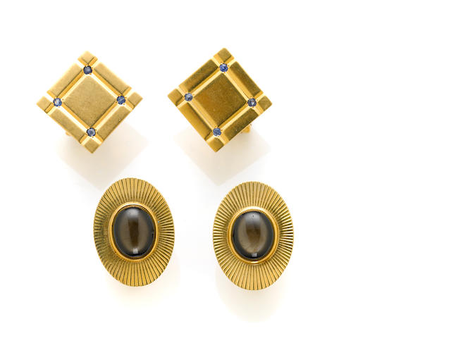 A pair of 14 karat gold and oval black star sapphire cufflinks; A pair of 14 karat gold and sapphire square cufflinks