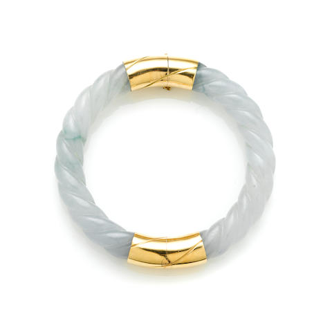 A carved jade and 14k gold twist motif bangle