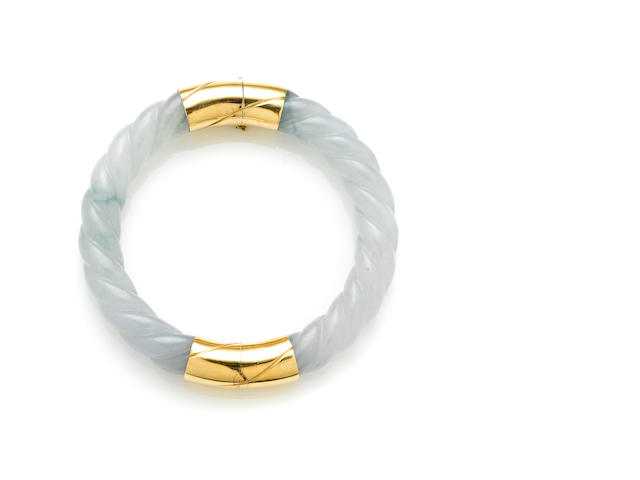 A carved jade and 4k gold twist motif bangle with twist motif