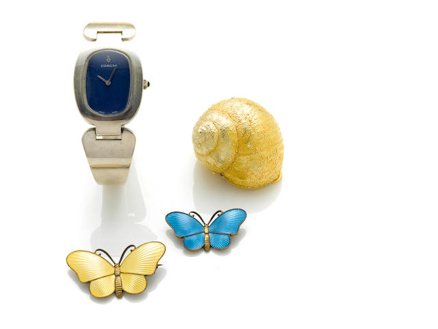 "A sterling silver Corum bangle watch ""The Love Bond"" model, with case; A pair of enamel and silver butterfly brooches, David Andersen; A gilt silver shell pill box, Tiffany & Co."