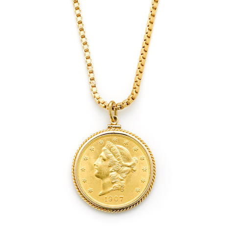 A $20 gold coin dated 1907 in a 14 karat gold bezel with 18 karat gold chain length 26in