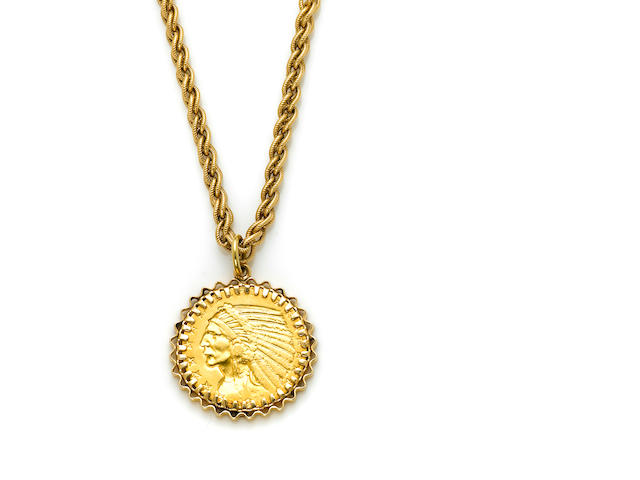 A $5 gold coin dated 1911 in a 14 karat gold textured bezel and matching chain length 26in