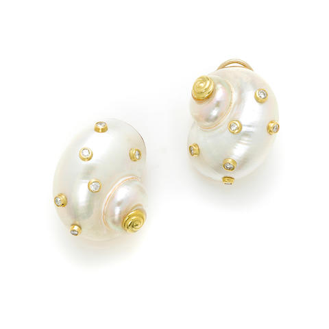 A pair of 14 karat gold, turbo shell and diamond ear clips