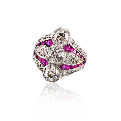 A three-stone diamond and ruby ring