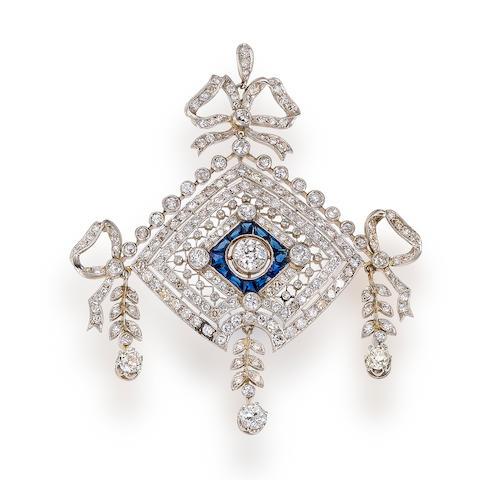 A diamond and sapphire pendant