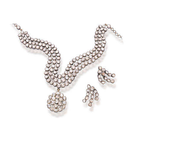 A diamond pendant necklace and pair of earclips