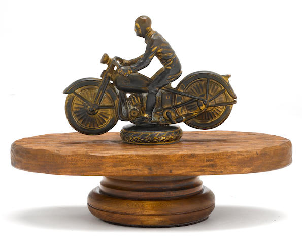A 1920s era motorcycle trophy top,
