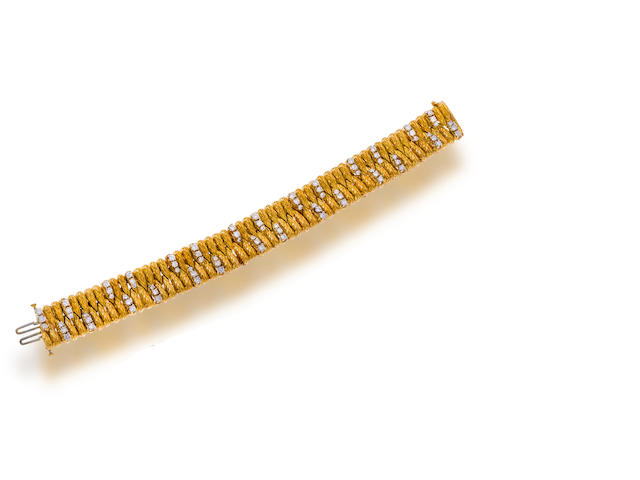 An eighteen karat gold and diamond bracelet