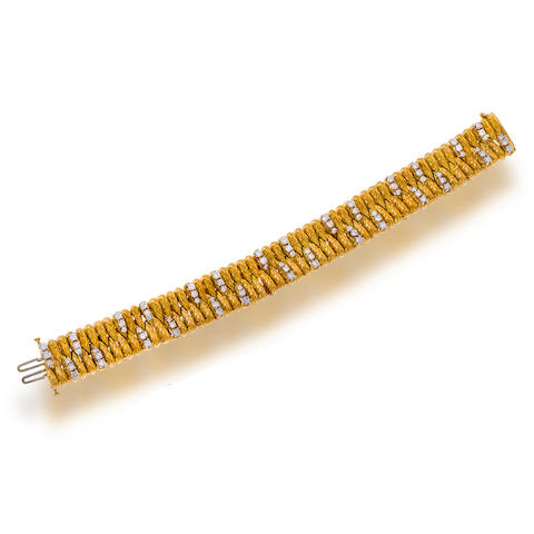 An eighteen karat gold and diamond bracelet