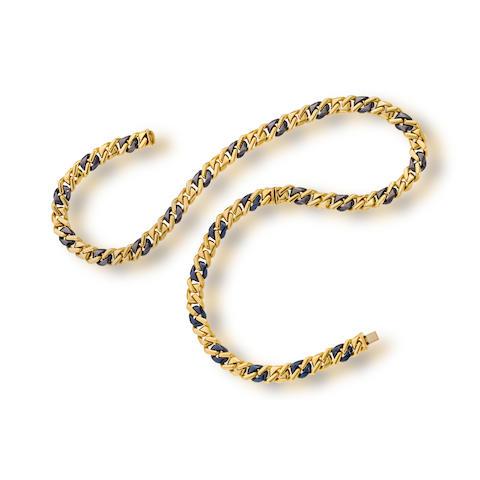 An eighteen karat gold and blackened steel necklace and bracelet