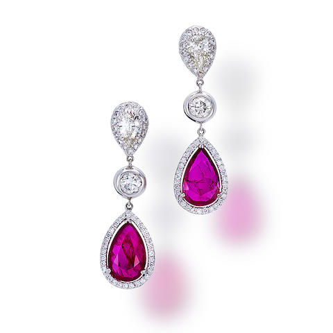 A pair of ruby and diamond pendant earrings