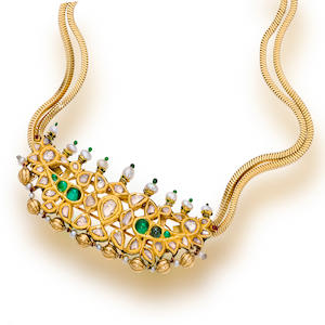 A gold and gem-set necklace, Cartier, French,