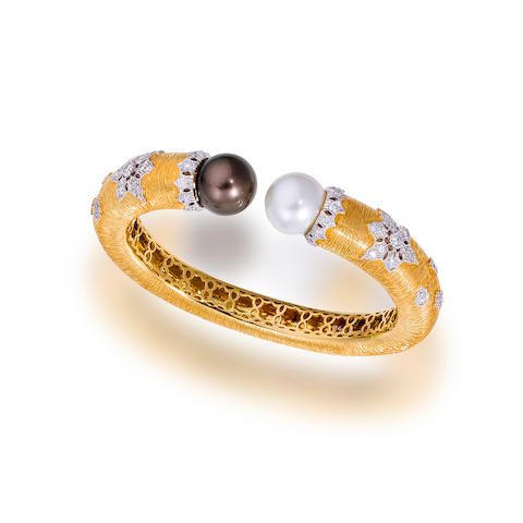 A South Sea cultured pearl and diamond bangle bracelet