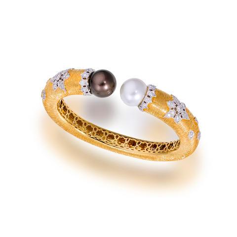 A South Sea cultured pearl and diamond bangle bracelet