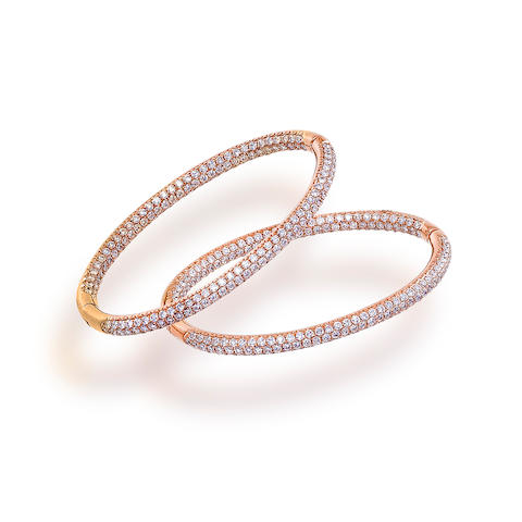 A pair of eighteen karat rose gold and diamond earrings