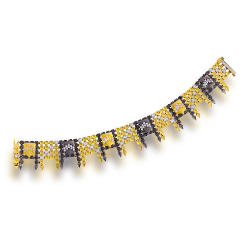 "An eighteen karat bicolor gold, diamond, and colored diamond ""Fairytale Shield"" bracelet, Paul Morelli"