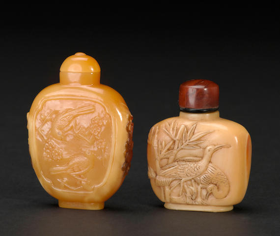Two carved hornbill snuff bottles