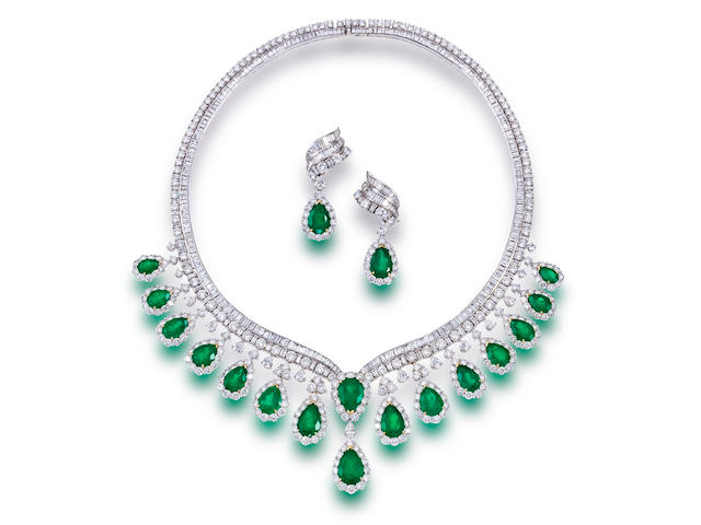 An emerald and diamond necklace and pendant earrings