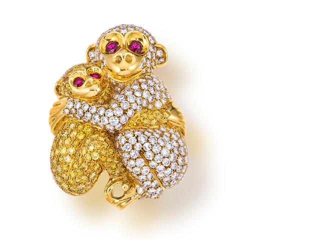 A colored diamond and diamond monkey brooch