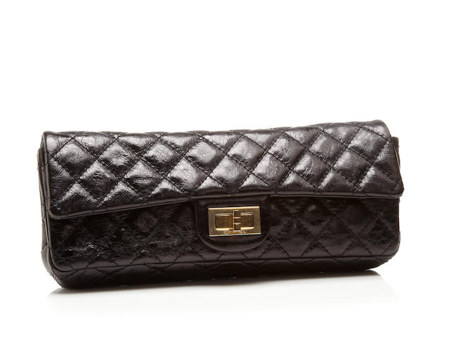 A Chanel black quilted leather clutch