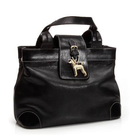 A Kieselstein-Co​rd black leather handbag, with poodle pendant detail