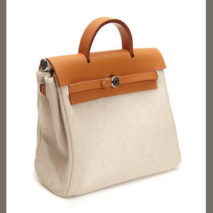 An Hermès canvas and leather Herbag handbag