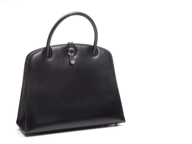 An Hermès navy blue leather Dalvy handbag