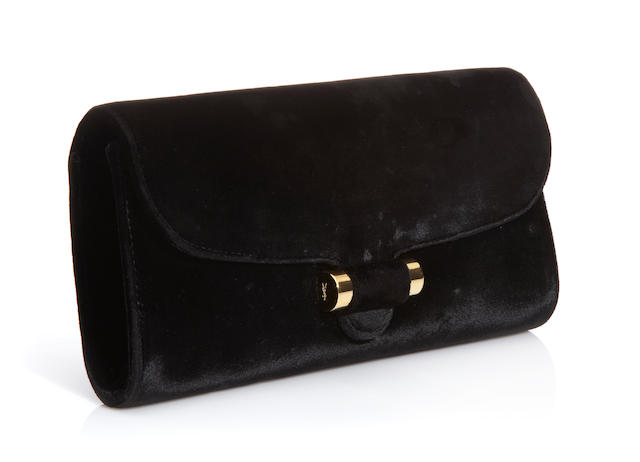 An Yves St. Laurent Rive Gauche black velvet clutch