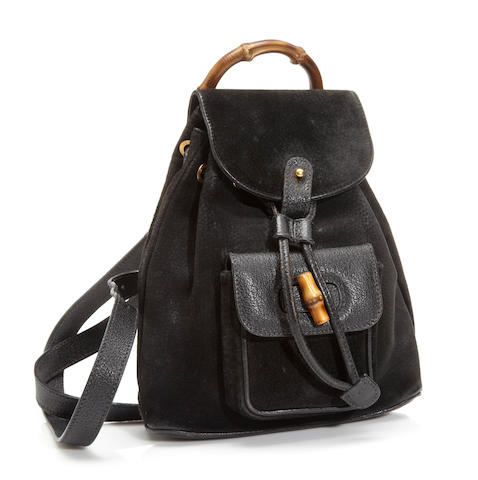 A Gucci black suede and leather backpack