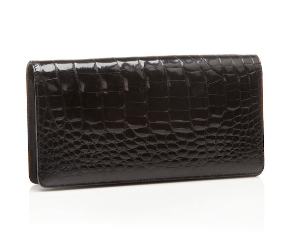 A black crocodile clutch