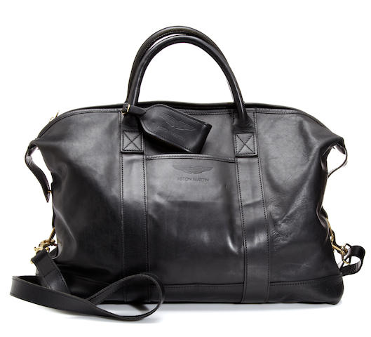 An Aston Martin black leather travel bag