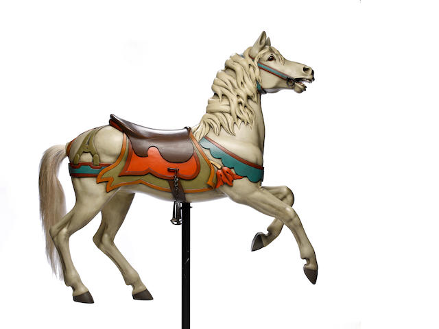 A carousel horse on stand