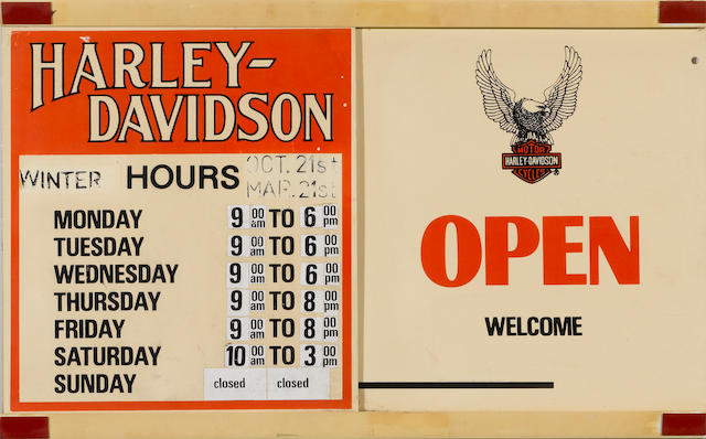 A Harley-Davidson dealership door sign,